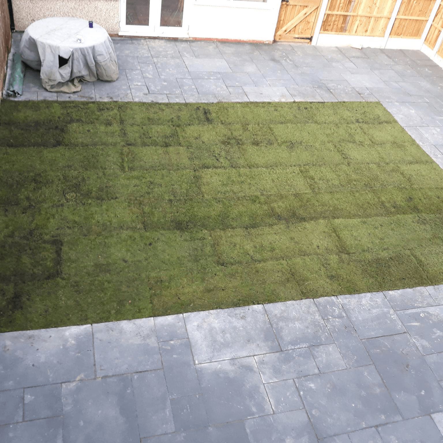 laid grass with stone patio